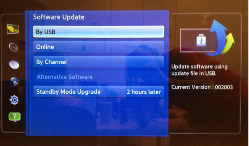 How can I manually update the firmware version on my Samsung